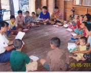 """The children with Pastor Joshua.....doing their studies."""